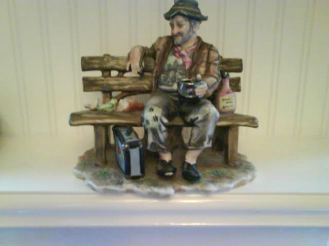 Tramp figurine on park bench with birds. Capodimonte with Mt Fuj