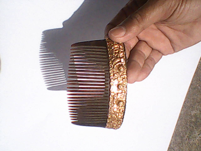 Century old comb made from water buffalo horn with pure gold des